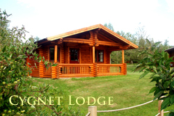Cygnet Lodge - luxury log cabin with hot tub in Northumberland