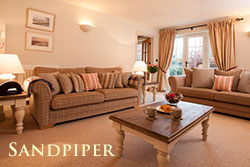 Sandpiper luxury holiday cottages sleeping 8 with pets welcome and private hot tub in Northumberland