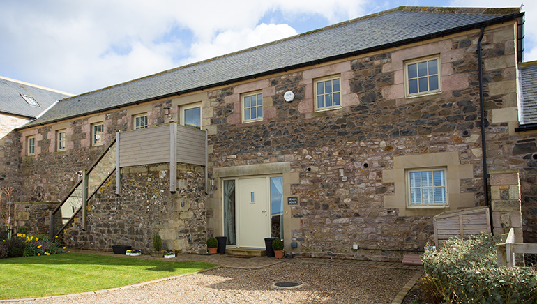 luxury holiday cottages in Bamburgh pet friendly with views of Bamburgh castle