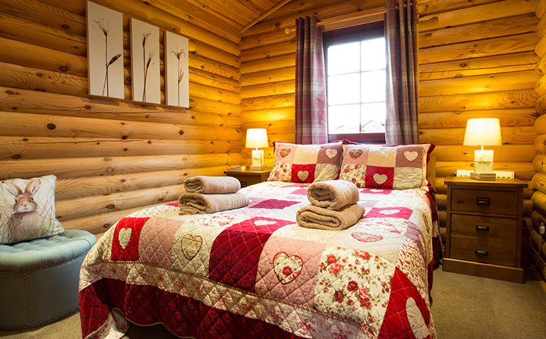master bedroom in kates cabin romantic holiday for couples with hot tub, cosy cabins self-catering in northumberland