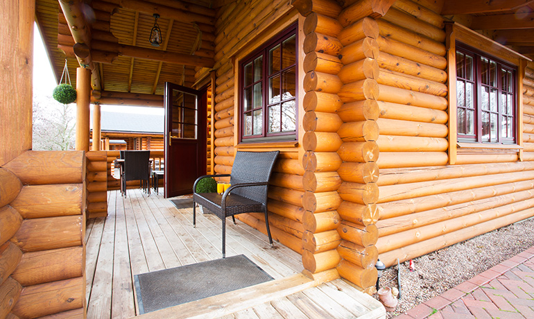verandah at kates cabin with private hot tub accommodation for families