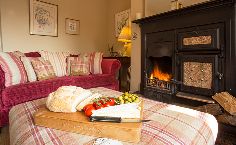 lounge with real fire at weavers cottages in otterburn, otterburn holiday cottages, cottages in otterburn, accommodation otterburn