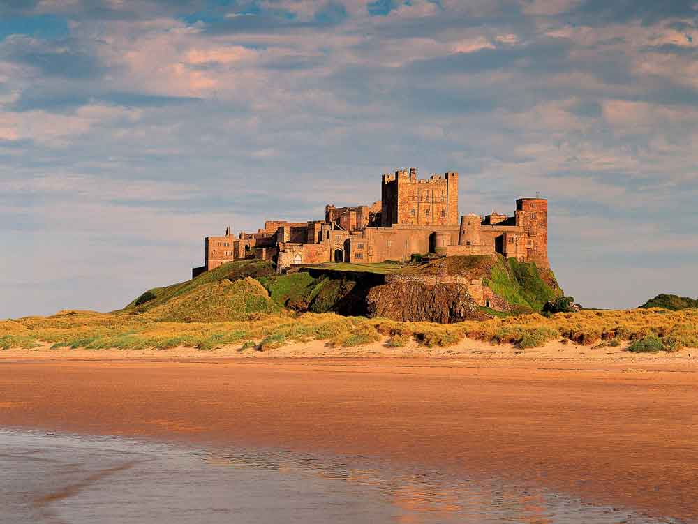 Visit Bamburgh Castle and coastline. Staying in luxury self-catering accommodation near Bamburgh, Northumberland.