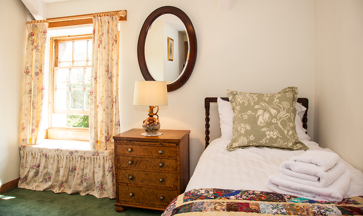 The single bedroom at Border House has rolling views out to the National Park and the Coquet Valley