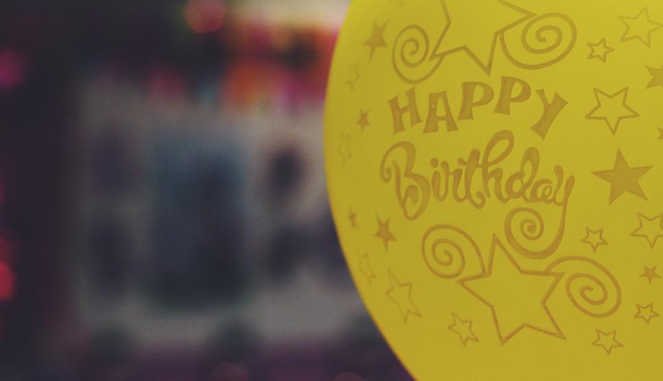 yellow birthday balloon
